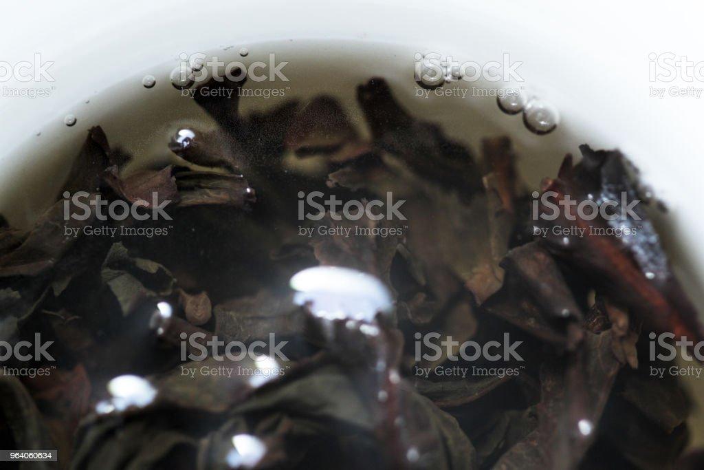 Close-up of Ban Tian Yao tea steeping in a white gaiwan - Royalty-free Chinese Tea Stock Photo