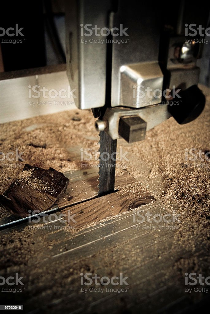 Closeup of Band saw with woodchips royalty-free stock photo