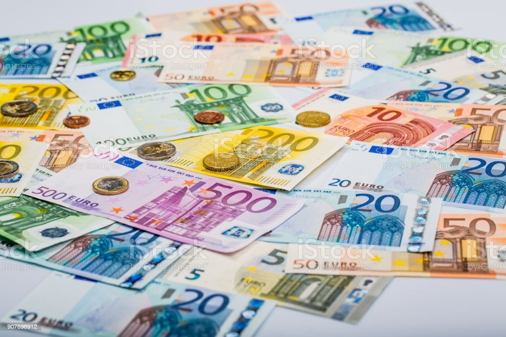 Closeup of banknotes and coins stock photo