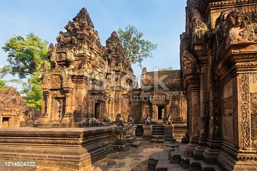 Banteay Srei, Cambodia - January 21, 2020: Banteay Srei is a 10th-century Cambodian temple dedicated to the Hindu god Shiva. It is built largely of red sandstone that can be carved like wood and millions of visitors admire the intricate reliefs carved in red colored sandstone.