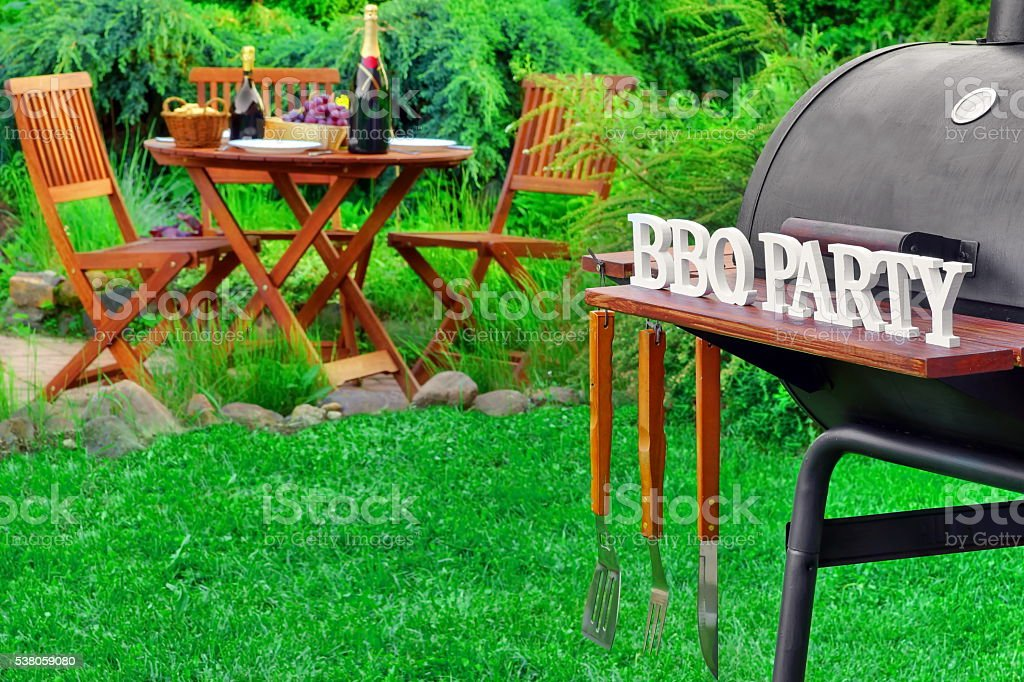 Close-up Of Barbecue Grill With Tools And BBQ Party Sign stock photo