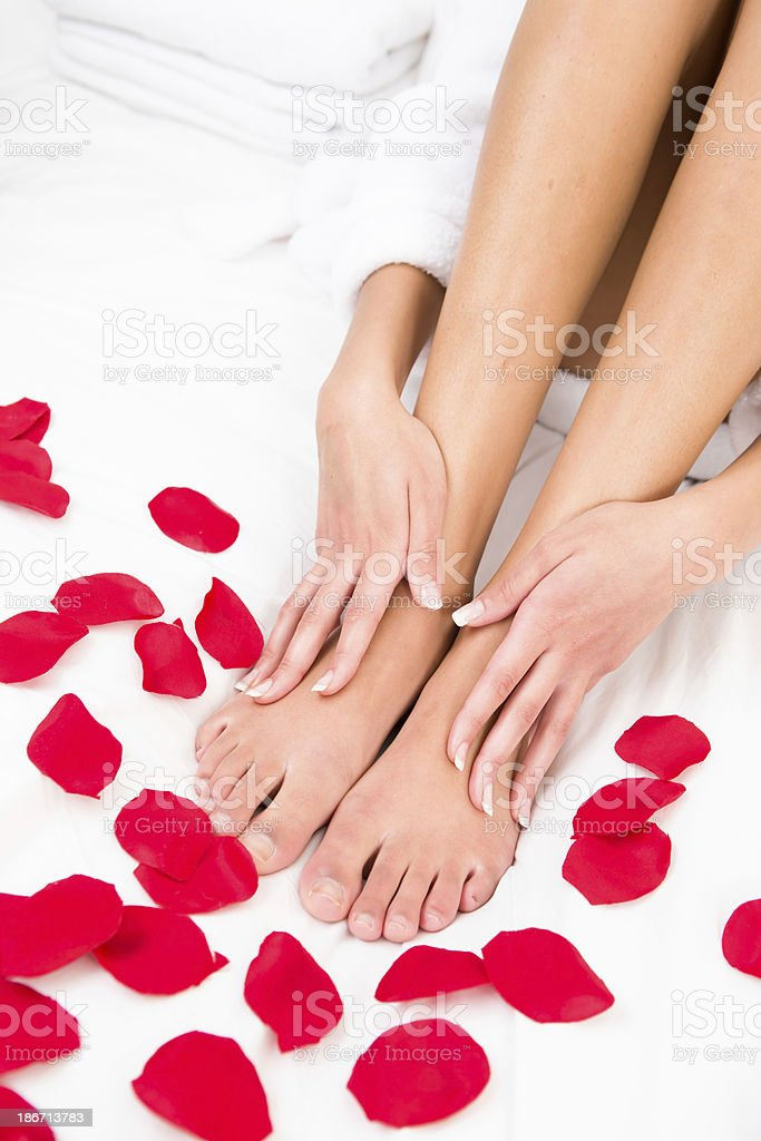 Close-up of barefoot on rose petals royalty-free stock photo