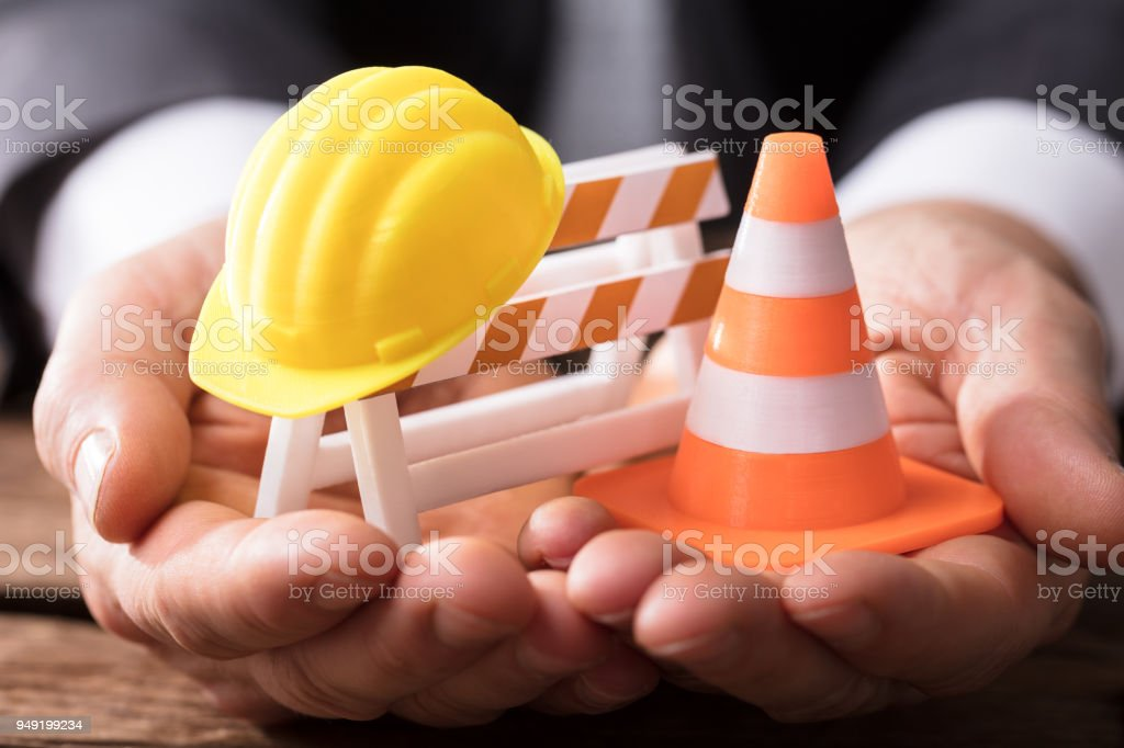 Close-up Of Barricade With Traffic Cone And Hard Hat stock photo