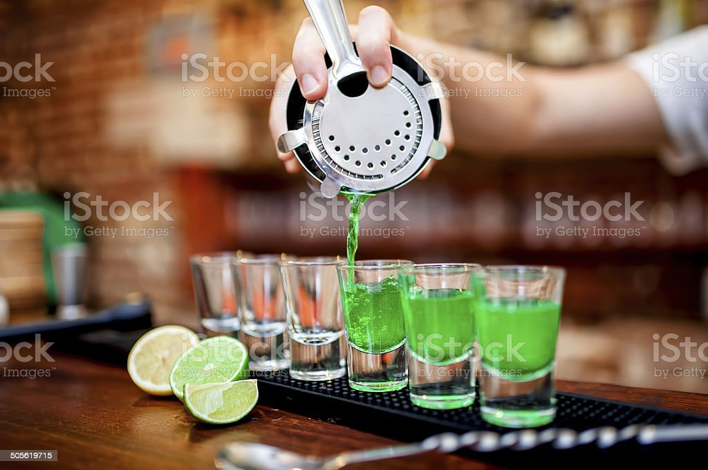 Close-up of bartender hand pouring alcoholic drink in restaurant stock photo
