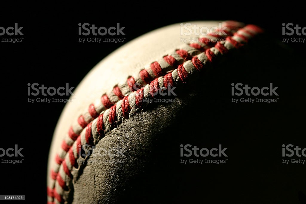 Close-Up of Baseball with Red Stitching, Low Key stock photo