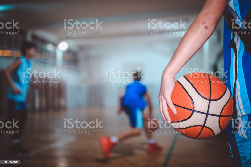 Close-up of basketball player holding a ball stock photo