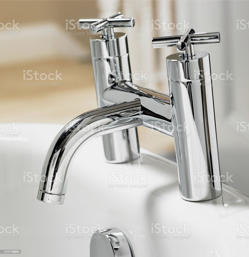 Closeup of bathroom faucet stock photo