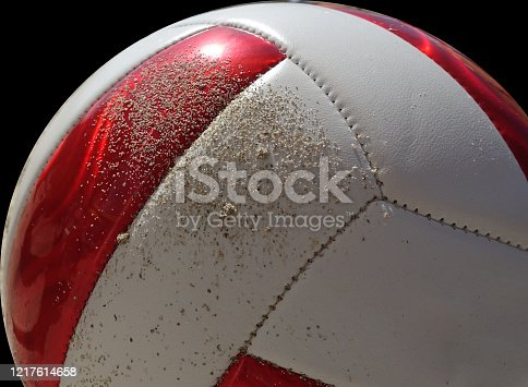 992854608 istock photo closeup of beach volleyball  on a black  background 1217614658