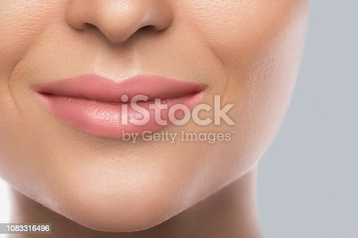 Close-up of beautiful female lips. Concept of face care or skin rejuvenation