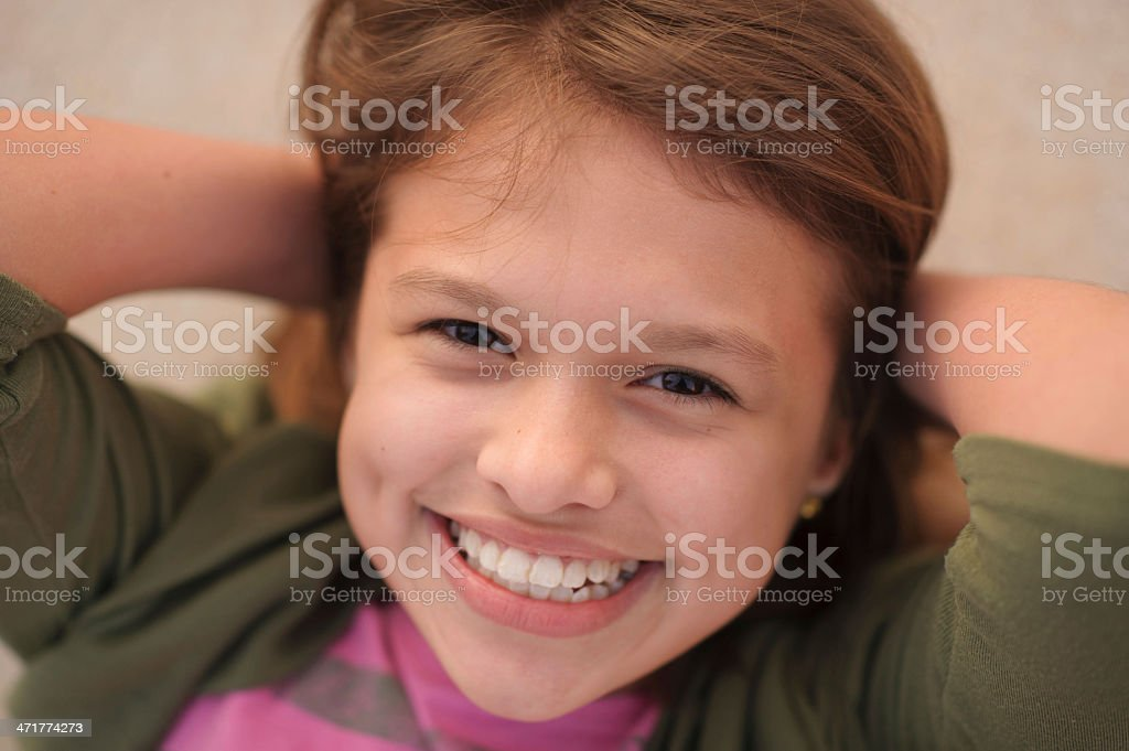 Closeup of Beautiful Girl with Dimples and Smiling royalty-free stock photo