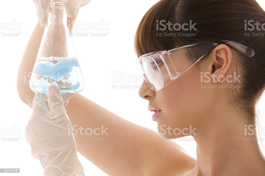 closeup of beautiful lab worker holding up test tube royalty-free stock photo