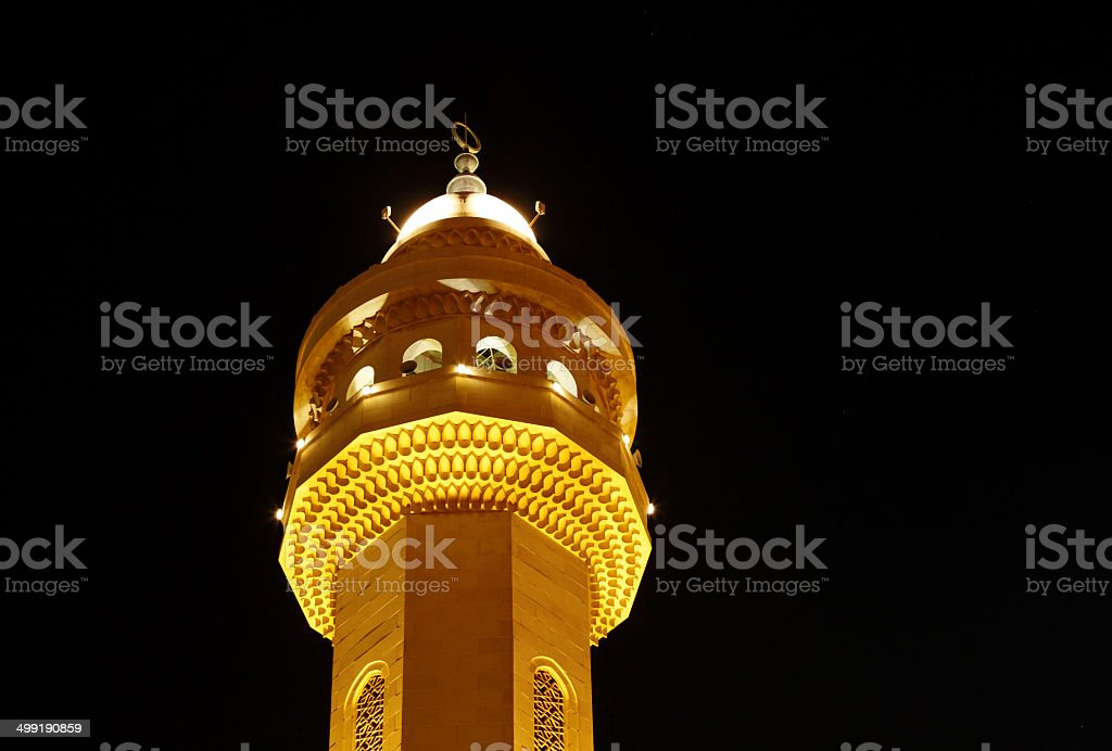 Closeup of beautiful minaret of Al Fateh Mosque at night stock photo