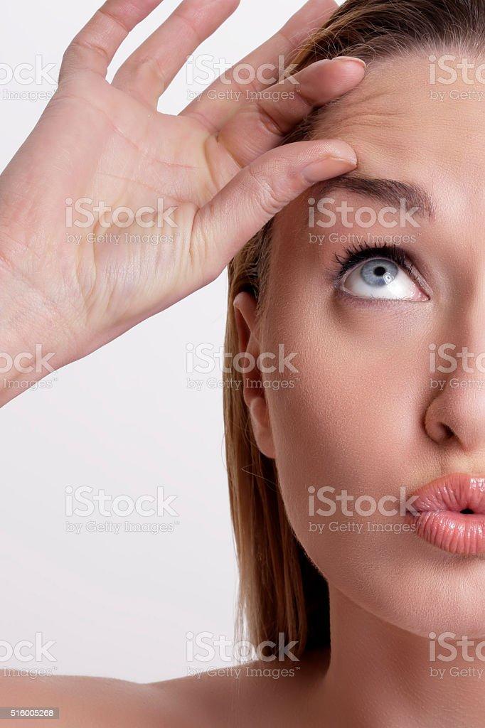 Closeup of beautiful model applying her skin treatment stock photo