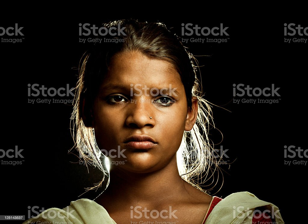 Close-up of beautiful, rural Indian girl looking at camera stock photo