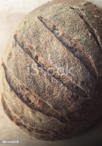 913749618istockphoto Close-up of beautiful whole wheat artisan sourdough bread 831443526