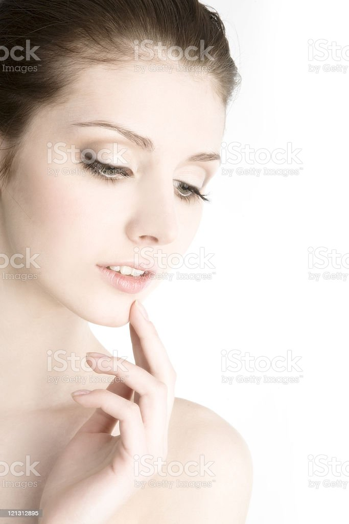 Close-up of  beautiful young tender woman looking down. royalty-free stock photo