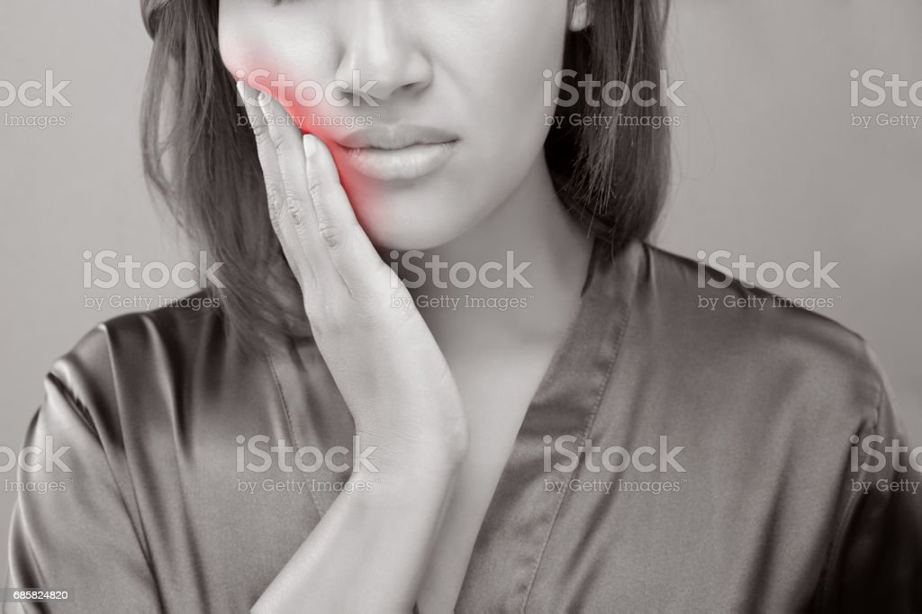 Closeup of beautiful young woman suffering from toothache, Dental health and care, People with teeth problem concept. stock photo