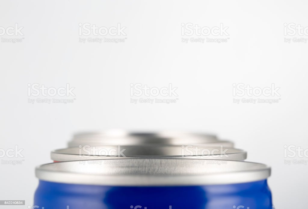 Closeup of beer cans or soda cans in a line. stock photo