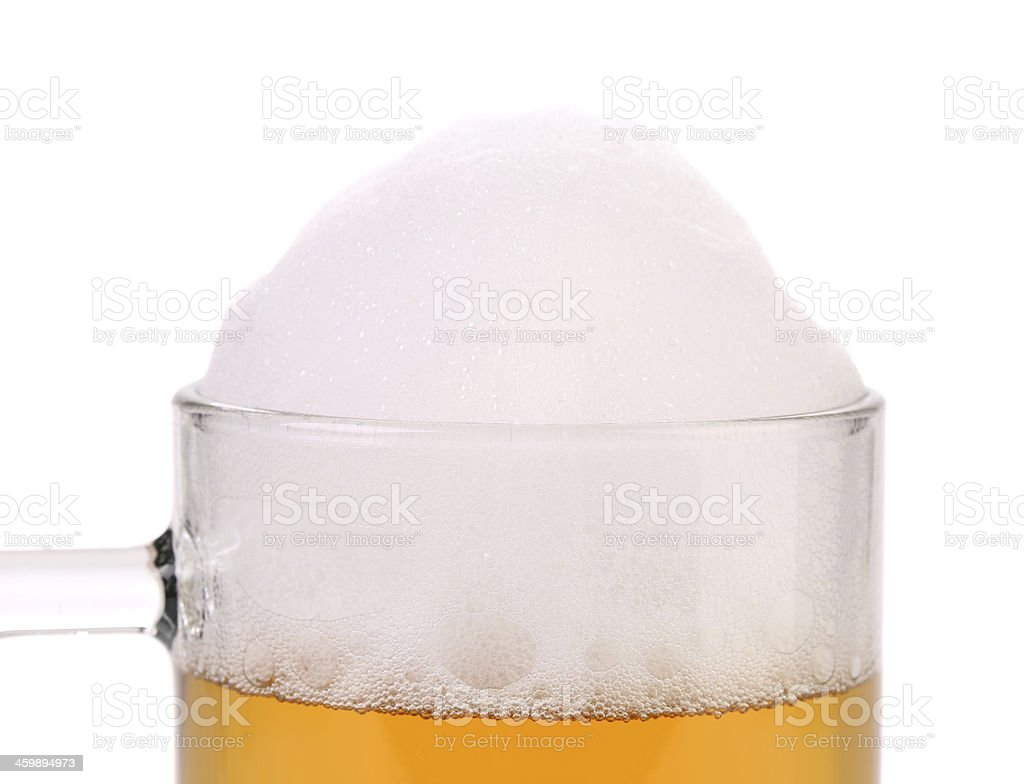 Closeup of beer glass with foam. stock photo
