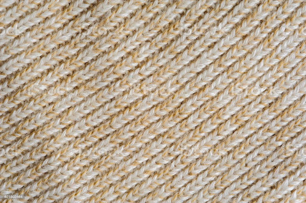 Closeup of beige knitted woolen fabric texture photo libre de droits