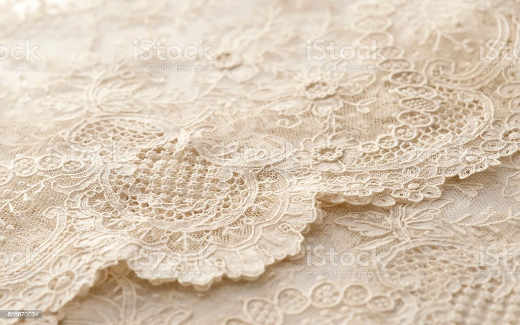 Close-up of beige lace fabric stock photo