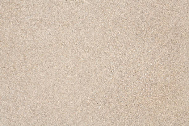 close-up of beige sandstone with finely pebbled texture - zandsteen stockfoto's en -beelden