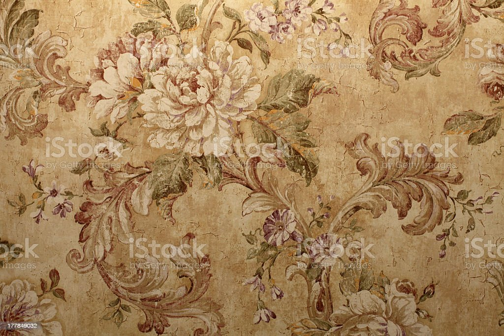 Close-up of beige vintage wallpaper with floral pattern