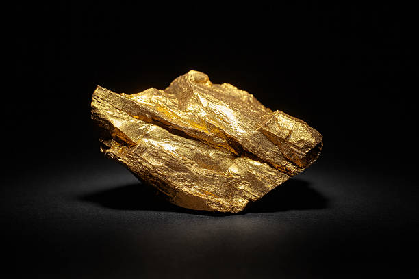 Closeup of big gold nugget Closeup of big gold nugget on a black background precious gem stock pictures, royalty-free photos & images