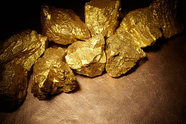 closeup of big gold nuggets - gold mine stock photos and pictures