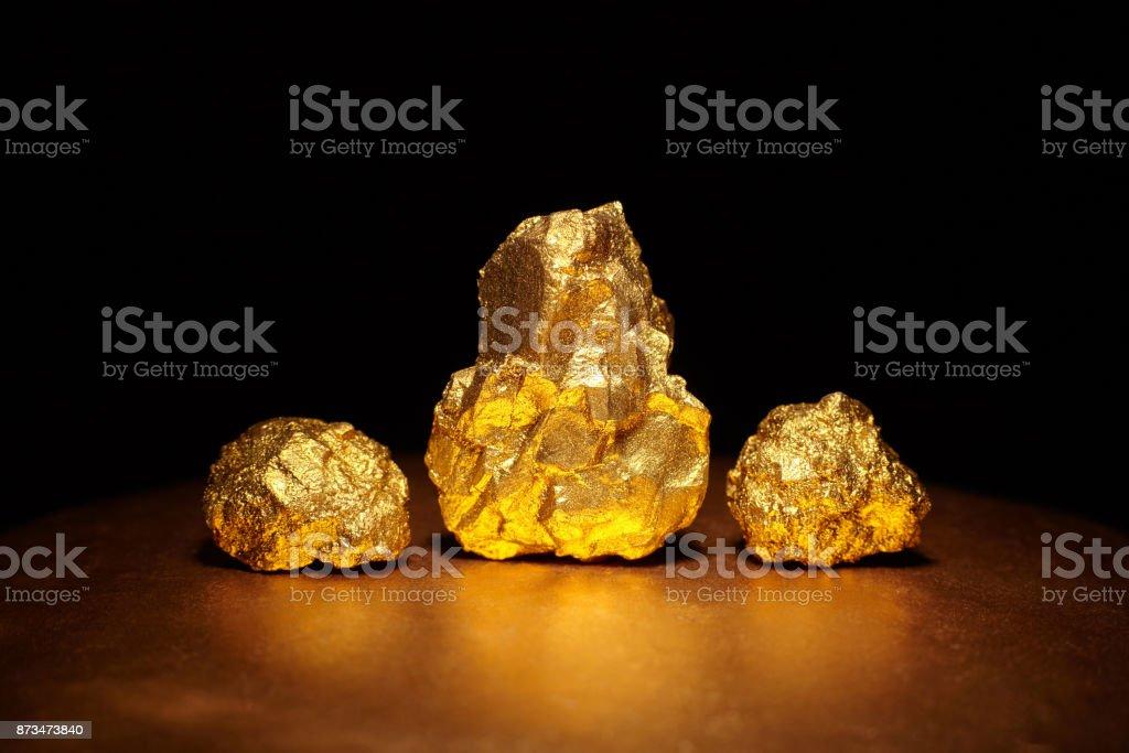 Closeup of big gold nuggets, finance concept