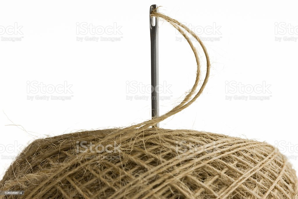 Closeup of big sewing needle in clew royalty-free stock photo