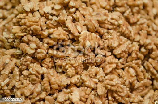 Closeup of big walnuts pile. walnut as background