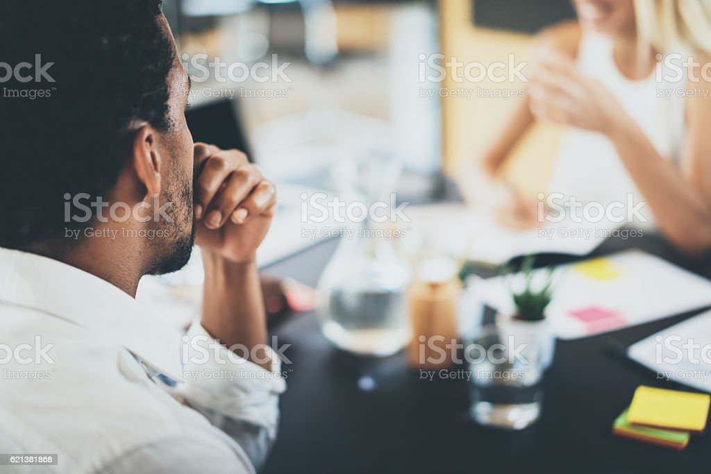Closeup of black african project manager during business meeting in stock photo