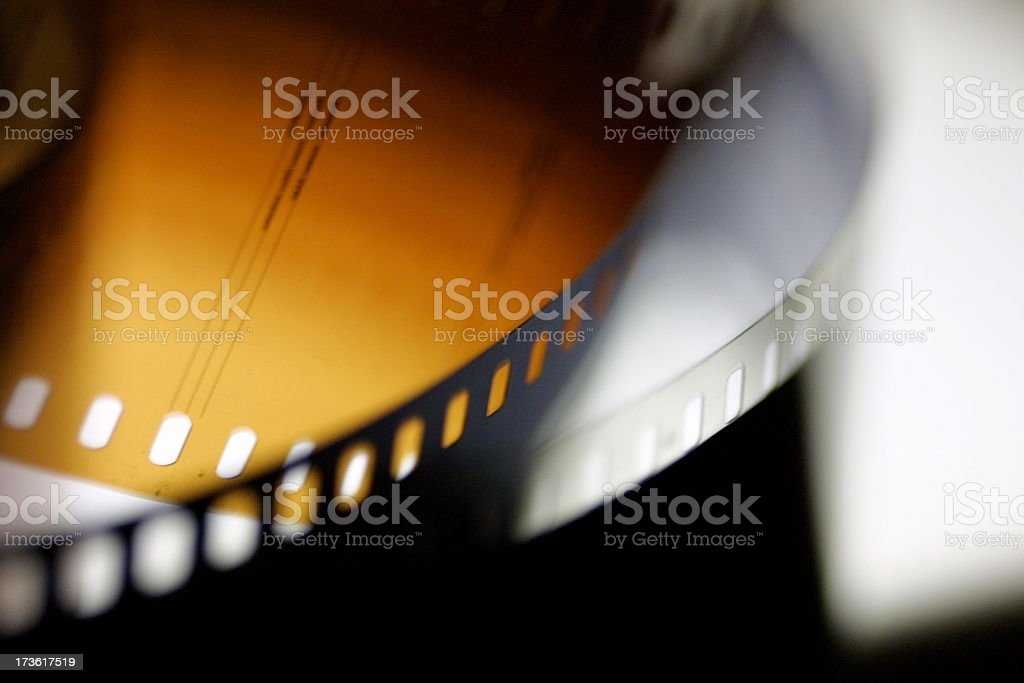 A closeup of black and yellow movie or photo film stock photo