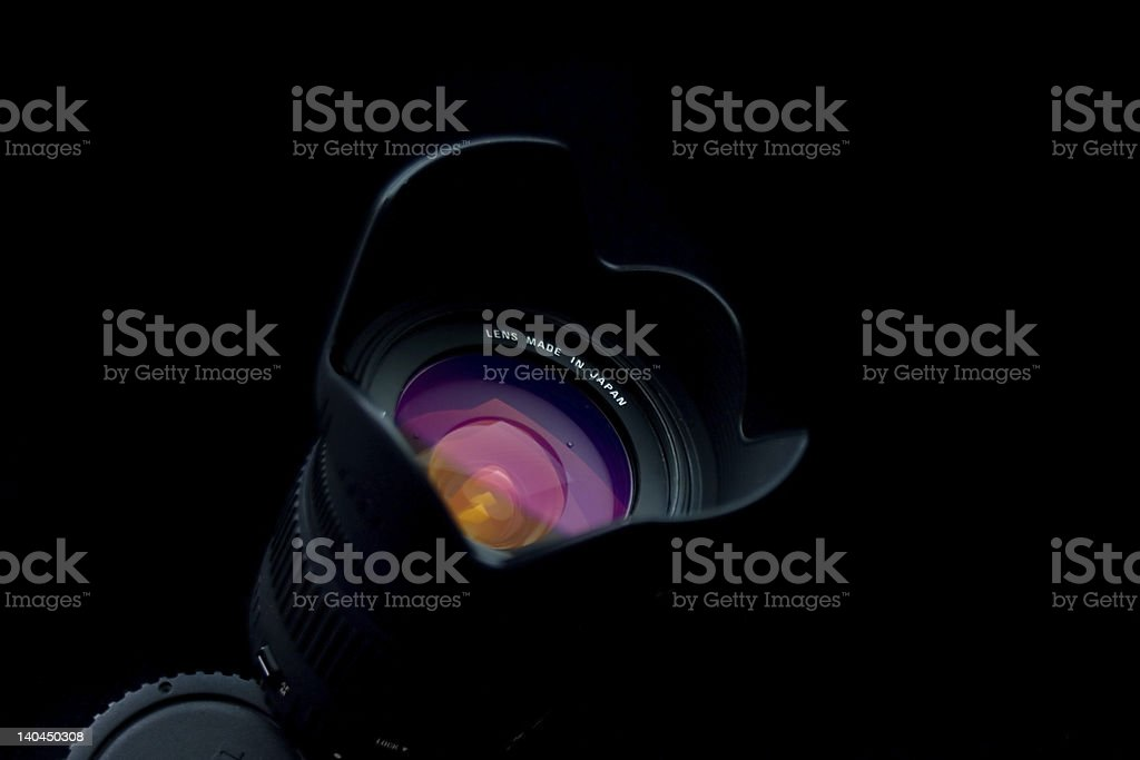 Close-up of black camera lens on black background stock photo