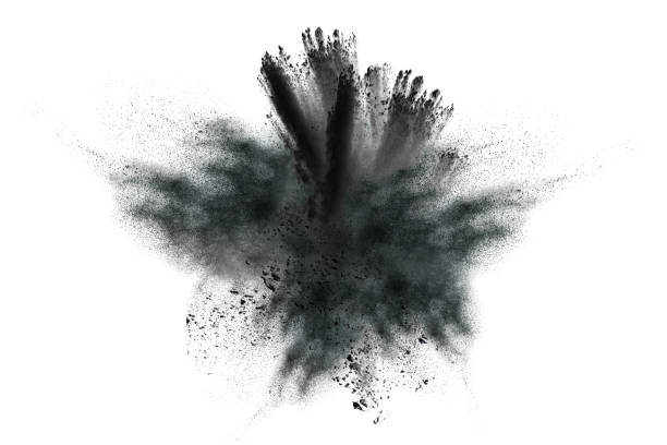 closeup of black dust particles explosion isolated on white background. - exploding stock pictures, royalty-free photos & images