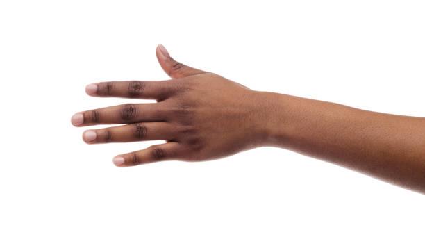 primer plano de la mano femenina negra aislada sobre fondo blanco - black people fotografías e imágenes de stock
