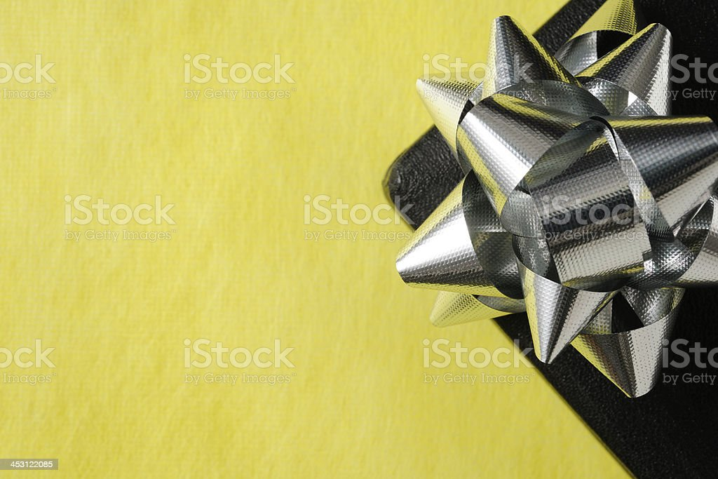 Close-up of black jewelry gift box with silver ribbon royalty-free stock photo