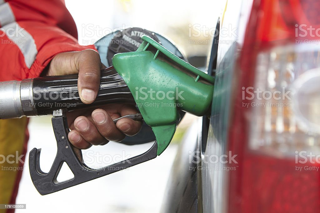 Close-up of black man's hand filling up a car royalty-free stock photo