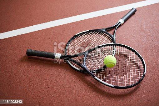 Rackets on tennis court