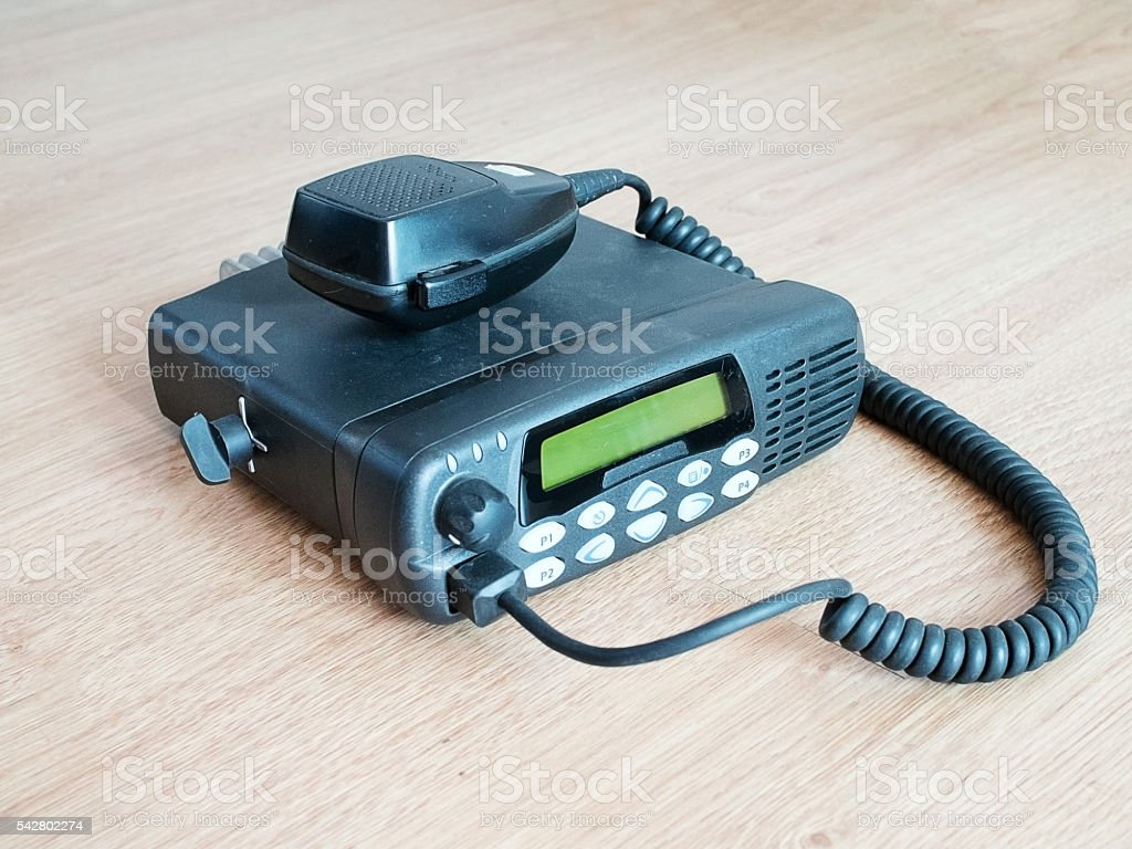 Closeup of black portable radio communication on wood floor stock photo
