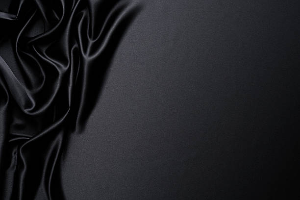 Close-up of black satin wave background with copy space stock photo