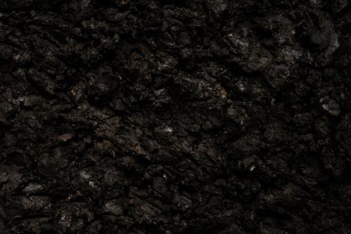 Close-up of black soil background.