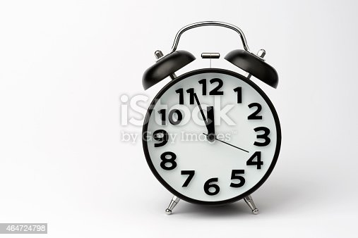 istock Close-up of Black Table Alarm Clock on White Background 464724798