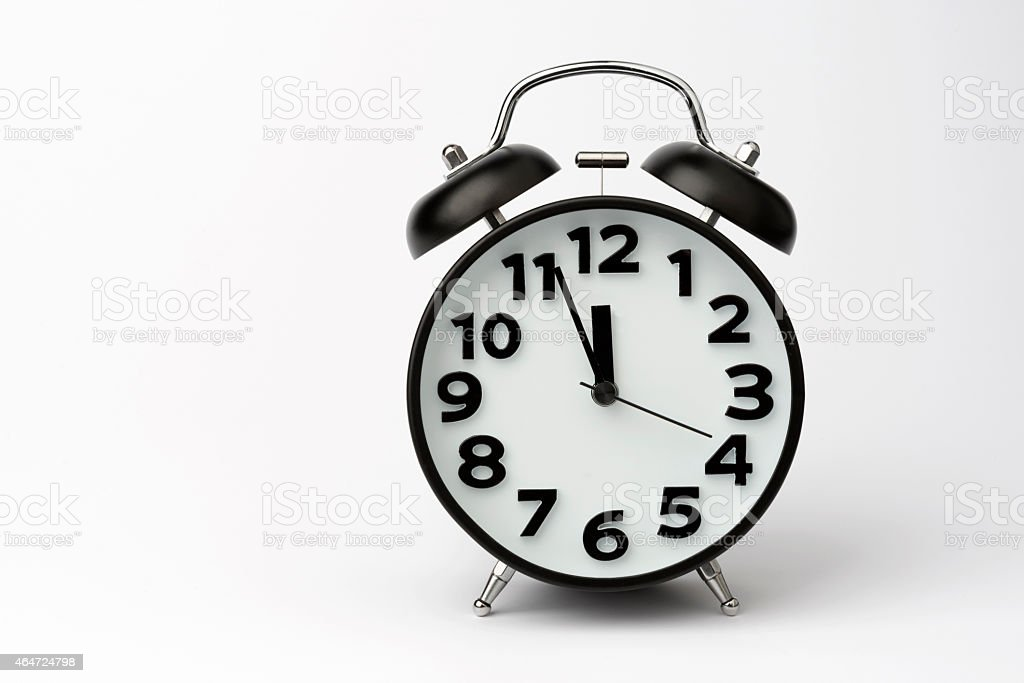 Close-up of Black Table Alarm Clock on White Background stock photo