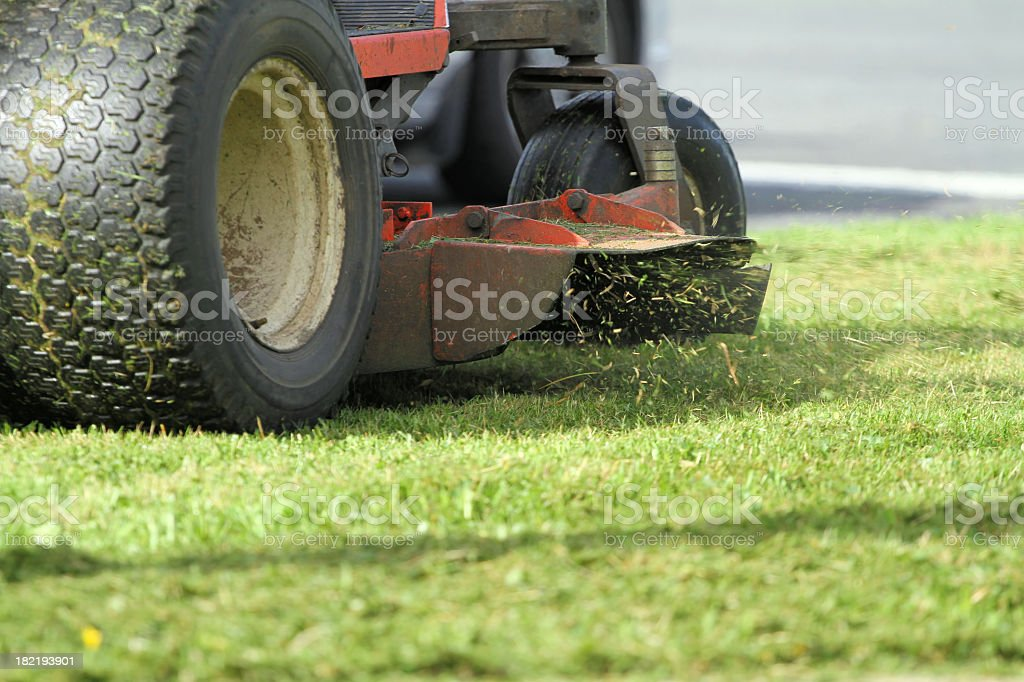 Close-up of blade cutting grass stock photo