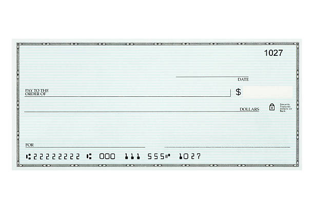 close-up of blank bank check sample against white background - blank check stock photos and pictures
