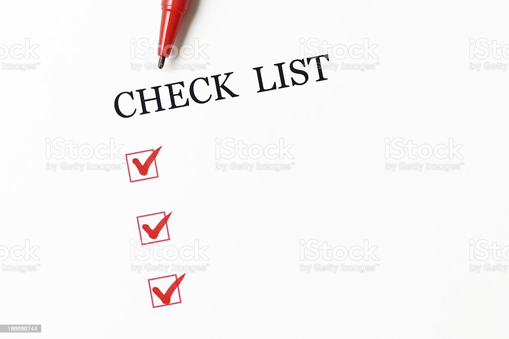 Close-up of blank checklist with red ball point pen royalty-free stock photo