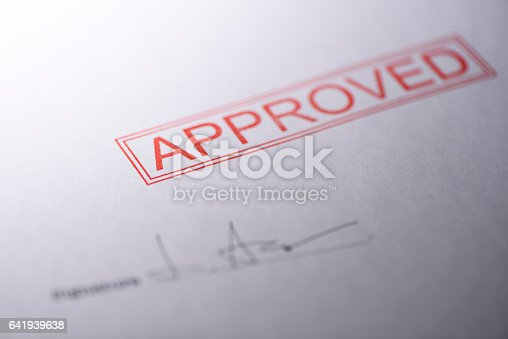 istock Close-up of blank contract form with approved stamped 641939638