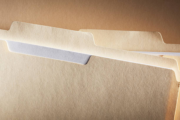 Close-up of Blank File Folder Tabs stock photo